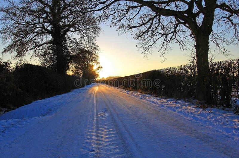 De Steeg van de zonsondergang in Sneeuw 004 royalty-vrije stock foto's