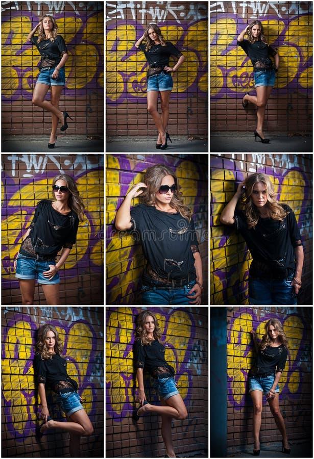 De stellende manier van het schoonheidsmeisje dichtbij rode bakstenen muur op de straat Jonge vrouw met zonglazen tegen een graff stock foto