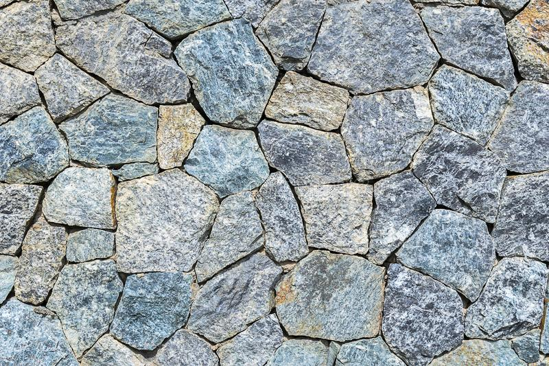 De stenen worden geschikt in rechthoekig royalty-vrije stock afbeeldingen