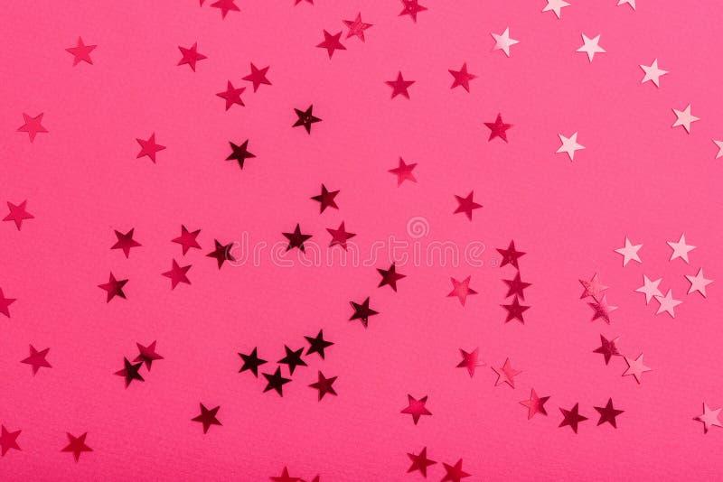 De ster bestrooit op roze stock afbeelding