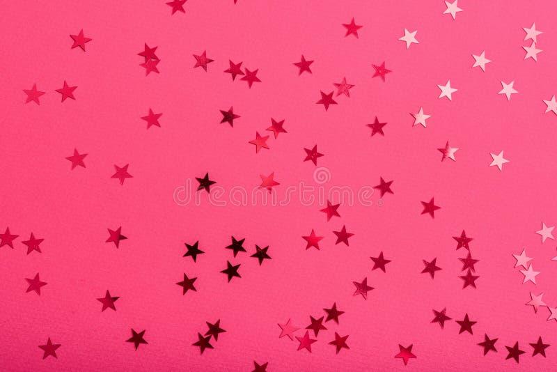 De ster bestrooit op roze stock foto's