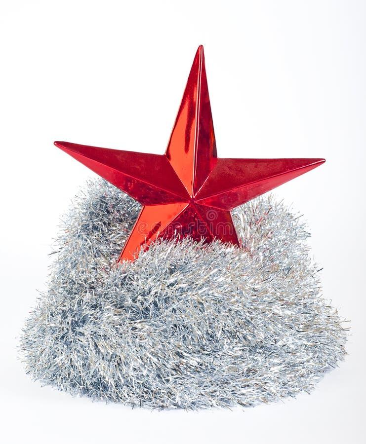 De ster van Kerstmis en zilveren klatergoud op wit stock foto's