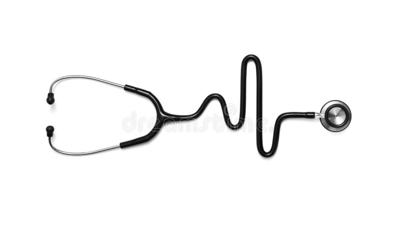 De stethoscoop in de vorm van een Hart sloeg op een electrocardiogram stock afbeelding