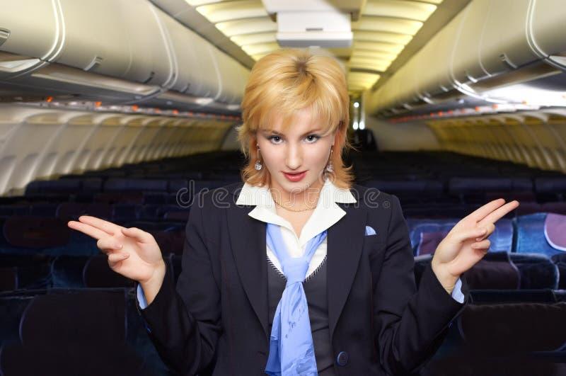De stewardess van de lucht het gesturing stock afbeeldingen