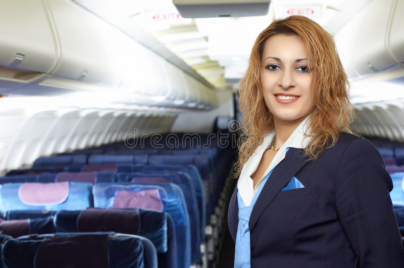 De stewardess van de lucht (stewardess) stock foto