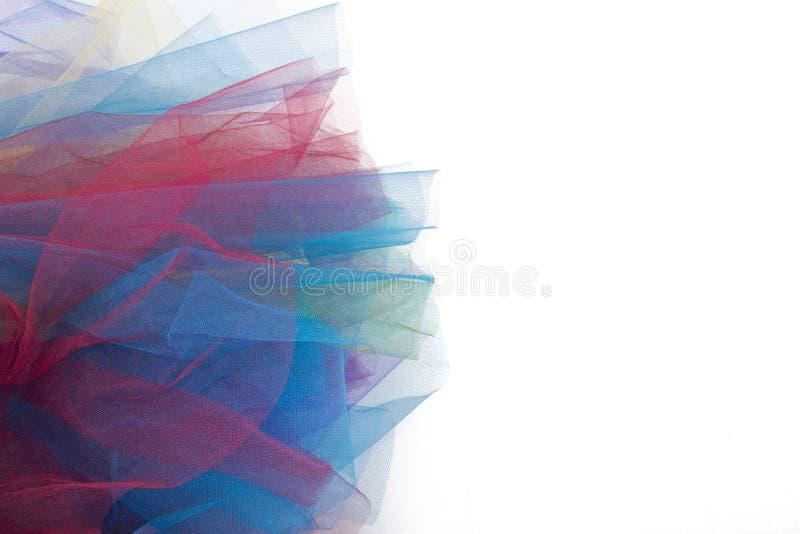 De stof van Tulle op witte achtergrond wordt geïsoleerd die stock fotografie