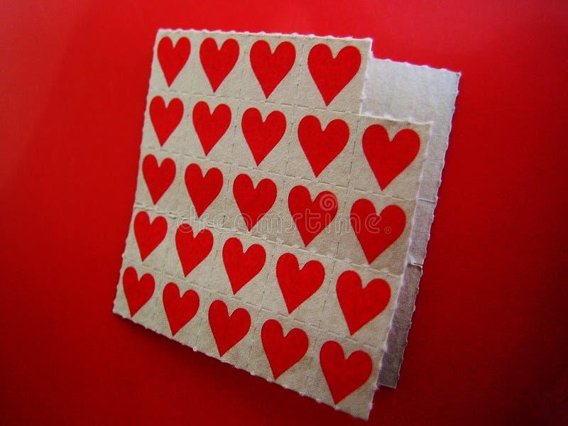 De stokdocumenten van LSD Kleine rode achtergrond macrobehangkleine lettertjes royalty-vrije stock fotografie
