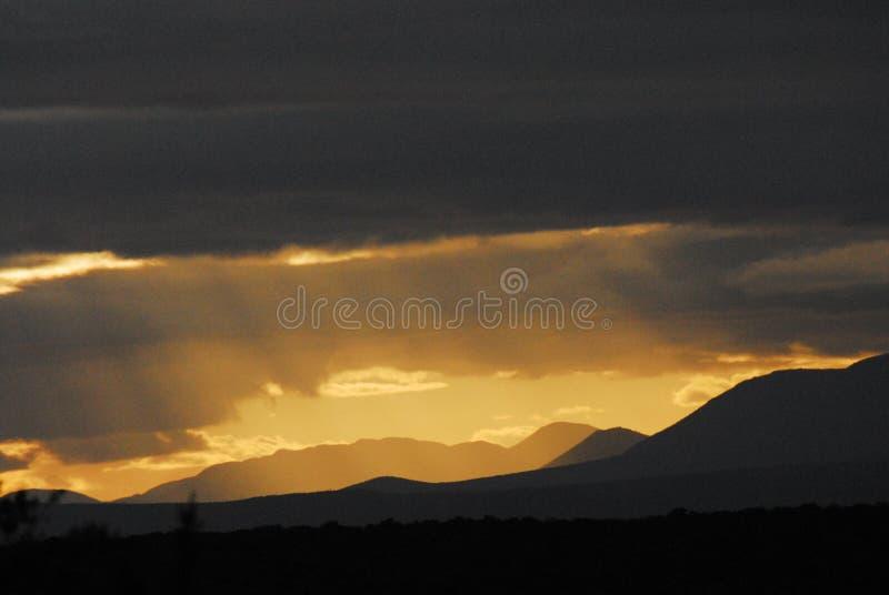 De Stormachtige Zonsondergang van Afrika stock fotografie