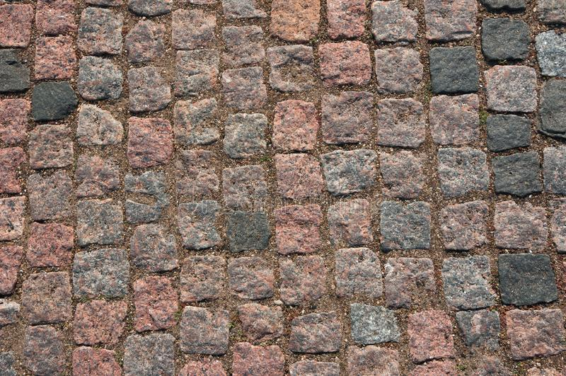 De straatsteen van de oppervlaktetextuur van rood graniet stock afbeeldingen