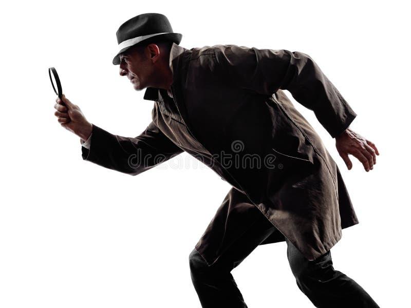 De strafrechtelijken onderzoeksilhouet van de detectivemens royalty-vrije stock foto's