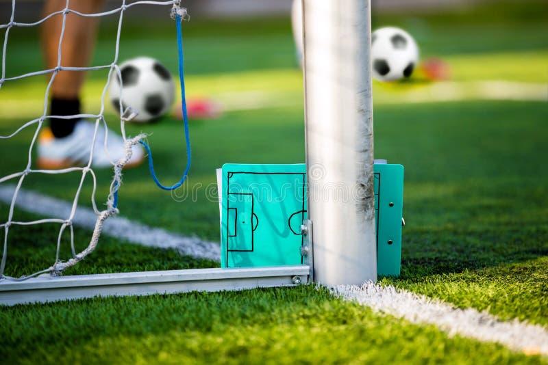 De strategie plannende raad van de voetbalvoetbal Het trainen voetbal royalty-vrije stock afbeelding