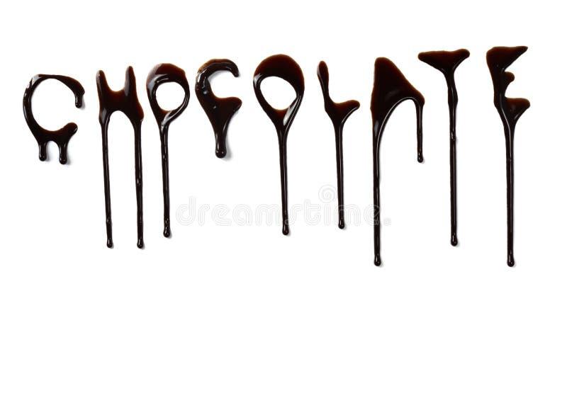 De stroop die van de chocolade vloeibare zoete voedselbrieven lekt stock foto's