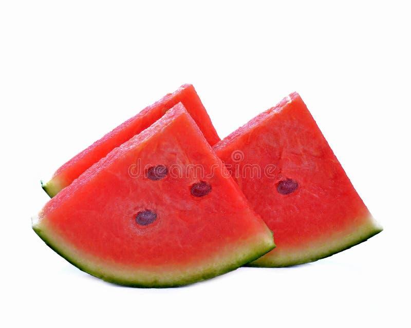 De stukken van de besnoeiingswatermeloen isoleerden witte achtergrond stock afbeeldingen