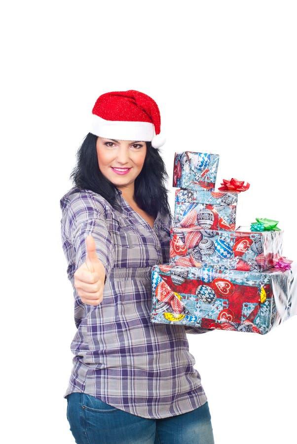 De succesvolle helper die van de Kerstman duimen geeft stock foto's