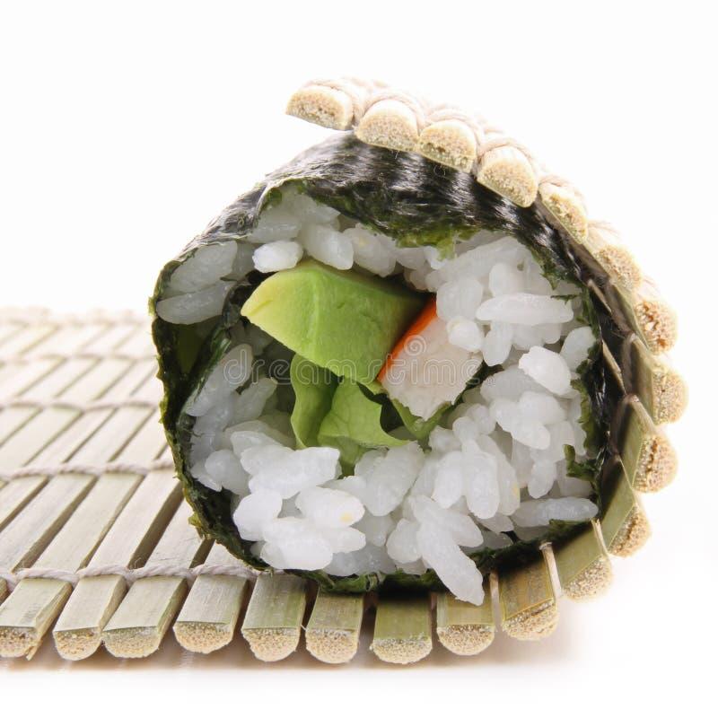 De sushimaki van Rolling royalty-vrije stock foto