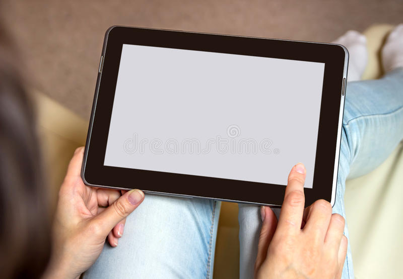 De tablet in handen Lichte achtergrond royalty-vrije stock afbeeldingen