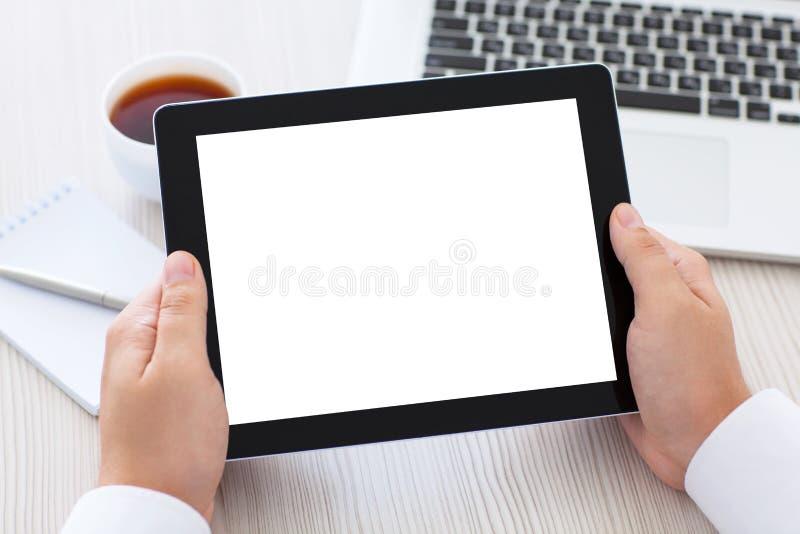 De tablet met het geïsoleerde scherm in mannetje overhandigt de lijst royalty-vrije stock foto