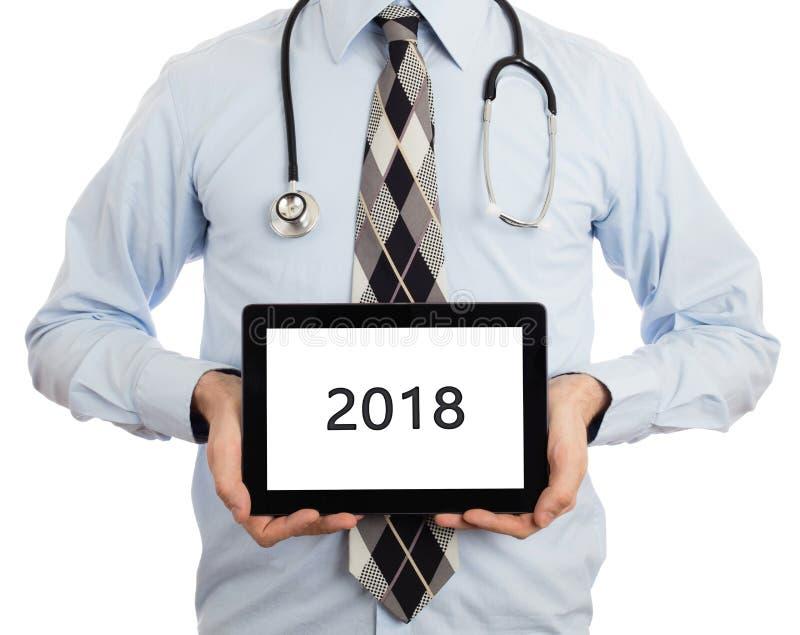De tablet van de artsenholding - 2018 stock afbeelding