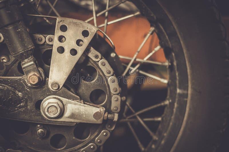 De tand en de ketting van de motorfiets royalty-vrije stock fotografie