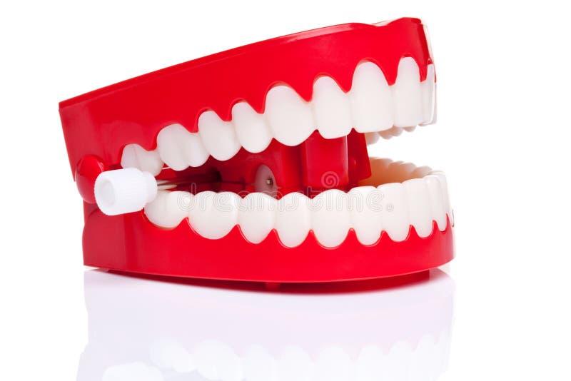 De tanden van Chattering stock foto