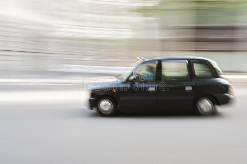 De taxi van Londen in motie royalty-vrije stock fotografie