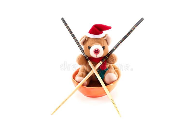 De Teddybeer van Kerstmis met eetstokjes. stock afbeelding