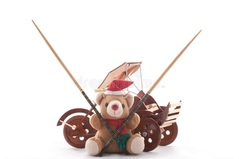 De Teddybeer van Kerstmis, riksja, en chpsticks stock afbeelding