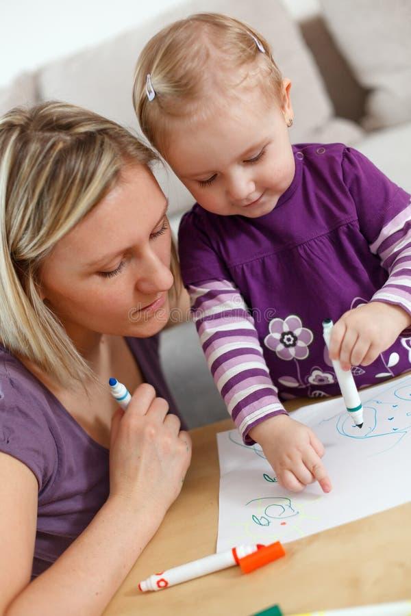 De tekening van de moeder en van het kind stock foto