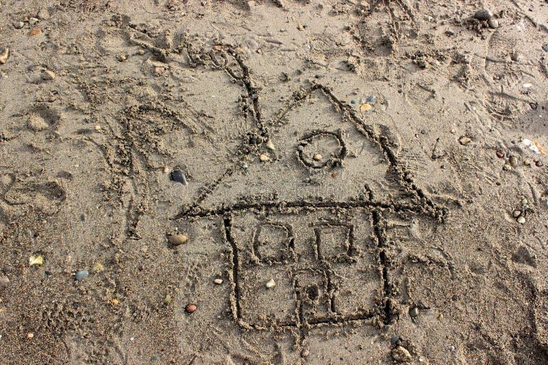 De Tekening van het kind van een Huis in Zand royalty-vrije stock afbeeldingen