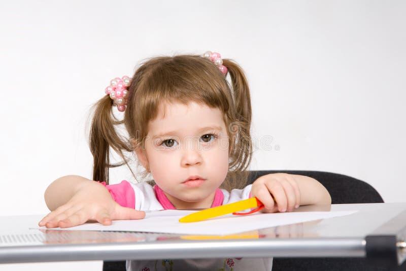 De tekening van het meisje met pen royalty-vrije stock foto's