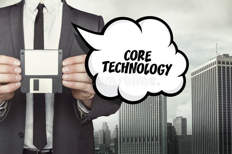 De tekst van de kerntechnologie op toespraakbel met zakenman stock illustratie