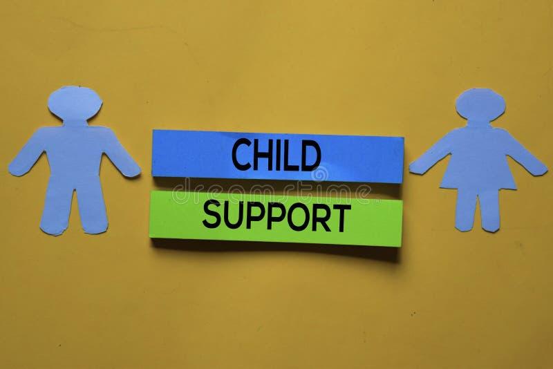 De tekst van de Steun van het kind op kleverige nota's Achtergrond bureaubureau stock foto's