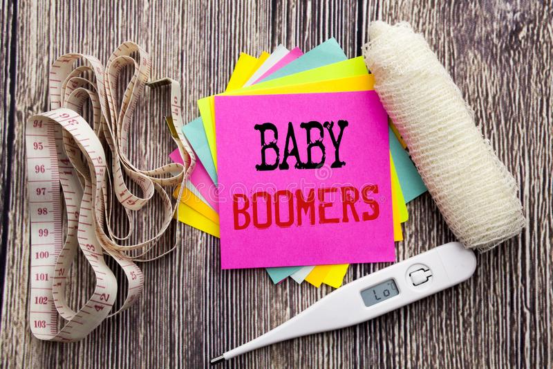 De tekstbaby Boomers van de handschriftaankondiging Het concept van de bedrijfsgeschiktheidsgezondheid voor Demografische Generat stock fotografie