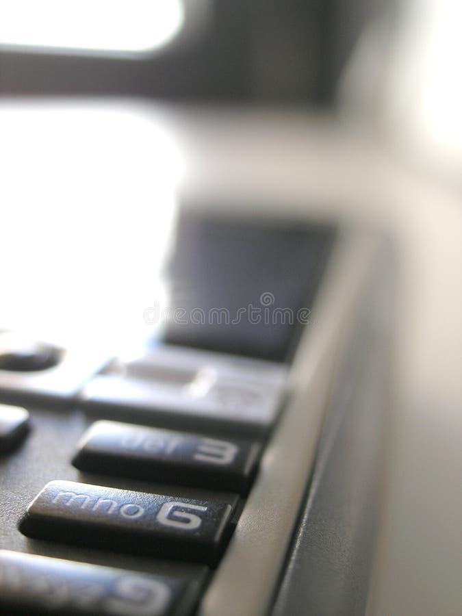 De telefoon van de cel in bureau royalty-vrije stock afbeelding