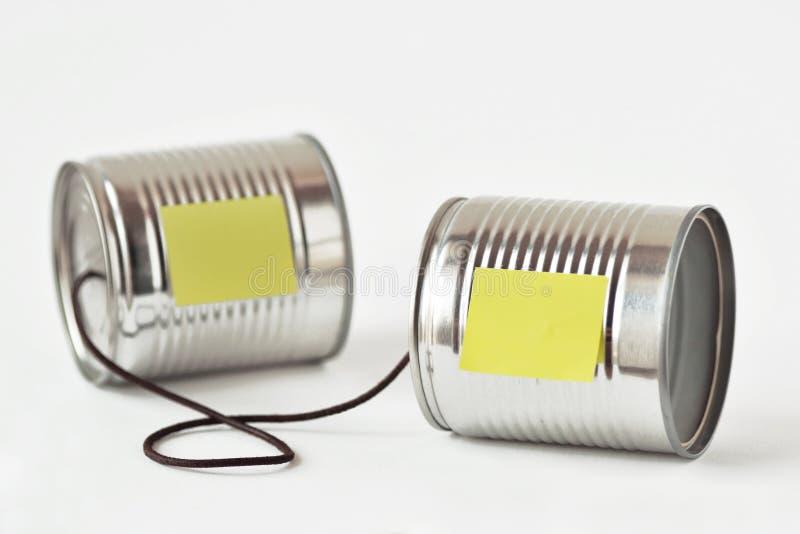 De telefoon van tinblikken met document nota - Communicatie concept royalty-vrije stock afbeeldingen