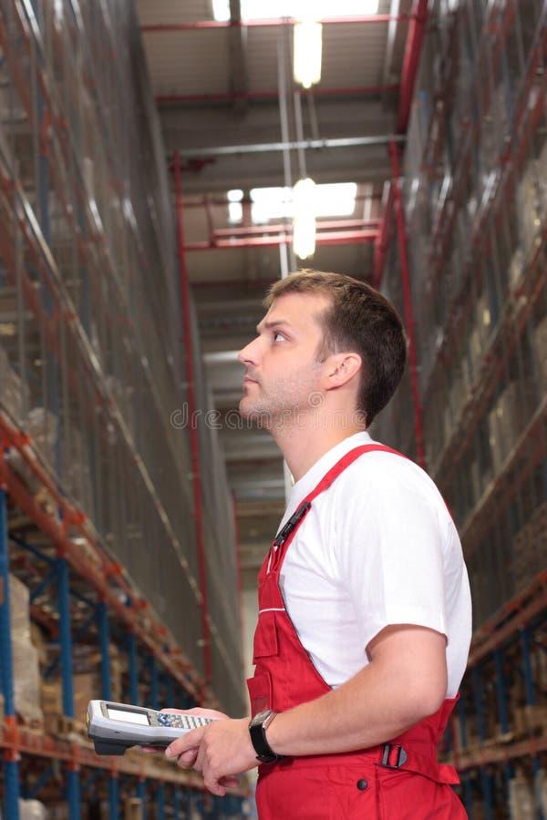 De tellende voorraden van de arbeider stock fotografie