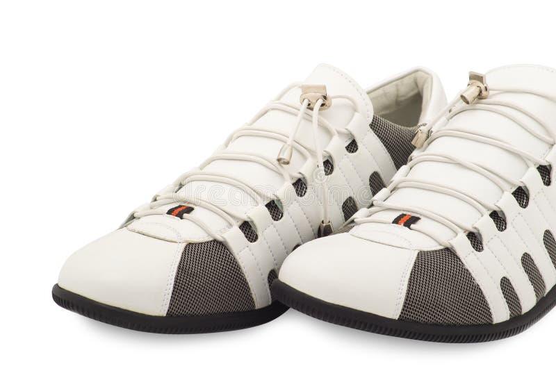 De tennisschoenen nieuw wit van modieuze mensen royalty-vrije stock afbeelding