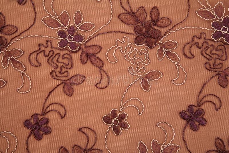 De textiel bruine textuur van de bloem stock afbeelding