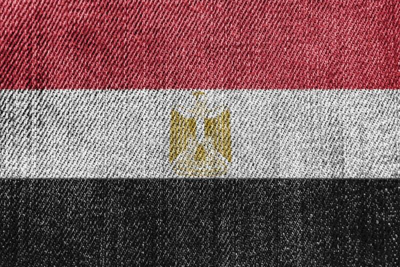 De Textielindustrie van Egypte of Politiekconcept: De Egyptische Jeans van het Vlagdenim stock foto's