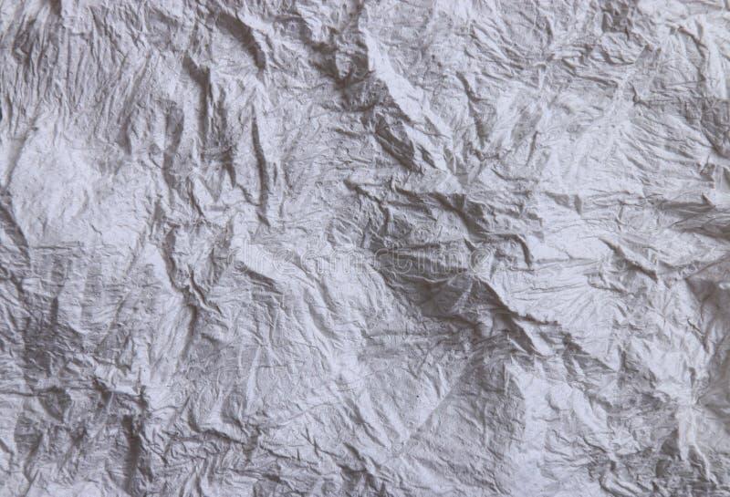 De textura del papel seda arrugado en el tono blanco y gris fotos de archivo