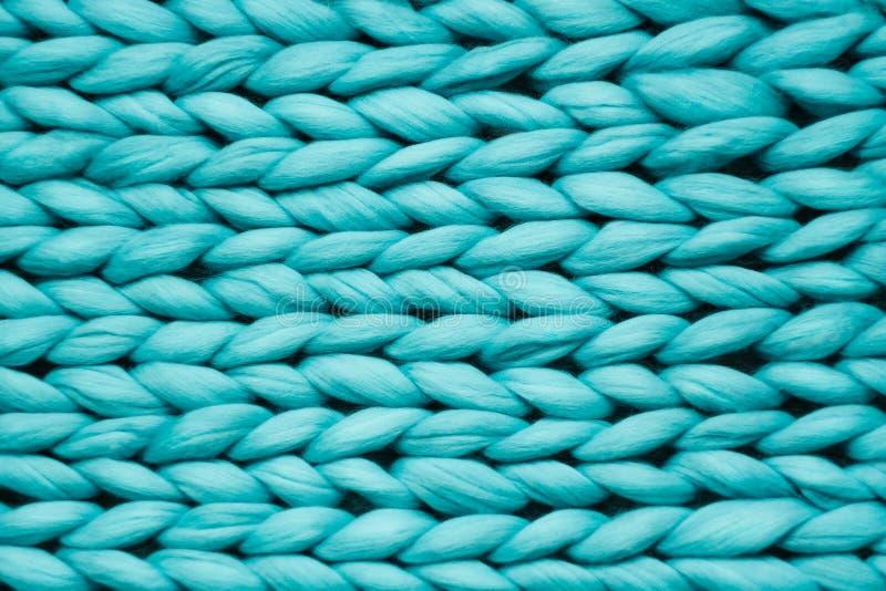 De textuur van blauw breit deken Het grote breien Plaid merinoswol Hoogste mening stock afbeeldingen