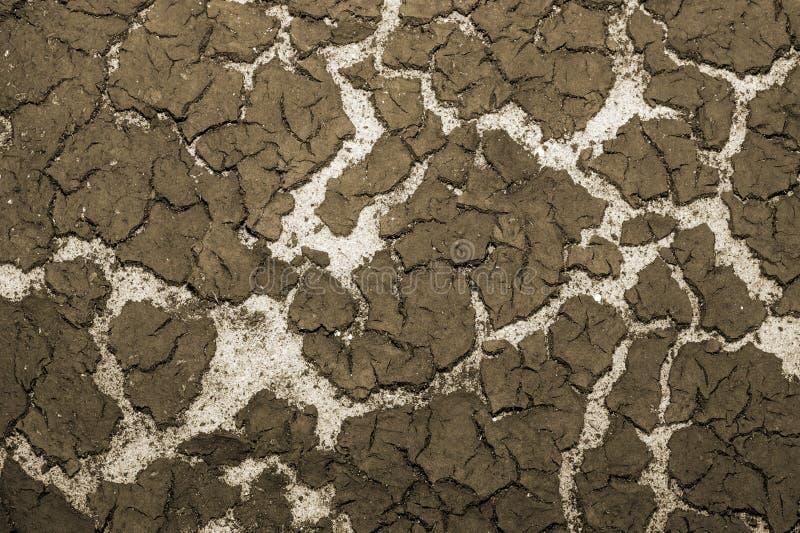 De textuur van de bodem van het reservoirzand en de accumulatie van slib op bovenkant Achtergrond toning stock foto's