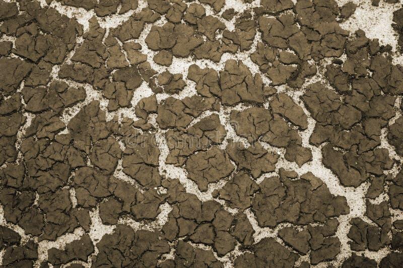 De textuur van de bodem van het reservoirzand en de accumulatie van slib op bovenkant Achtergrond toning royalty-vrije stock afbeelding