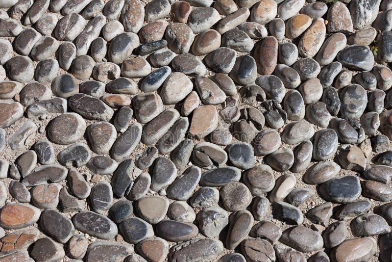 De textuur van de de steenweg van kiezelstenen stock afbeeldingen