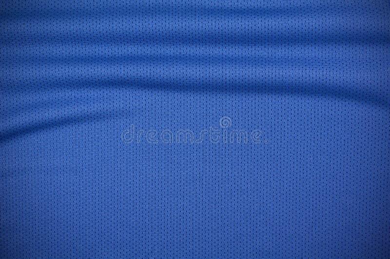 De textuur van de het overhemdskleding van sportjersey in blauw stock foto's
