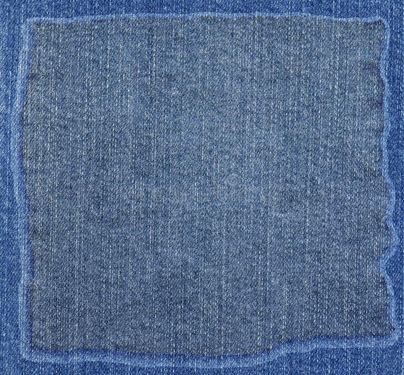 De textuur van de jeansstof met kader royalty-vrije stock fotografie
