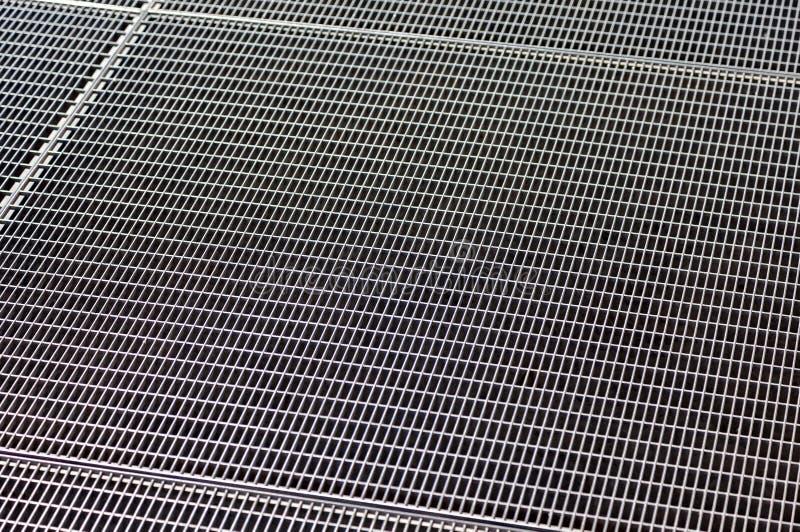 De textuur van de metaalgrill met gaten royalty-vrije stock afbeelding