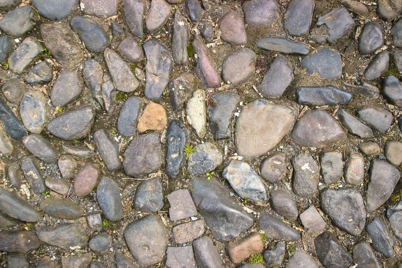De textuur van de steenbestrating Het graniet cobblestoned achtergrond stock afbeelding