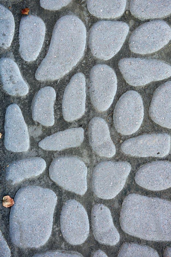De textuur van de steenbestrating Het graniet cobblestoned bestratingsachtergrond stock afbeelding