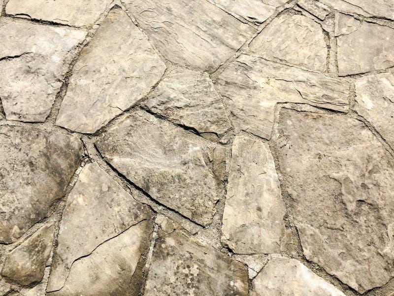 De textuur van de steenbestrating Het graniet cobblestoned bestratingsachtergrond Abstracte achtergrond van het oude close-up van royalty-vrije stock foto